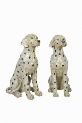 A PAIR OF LIFE-SIZED HAND-CARVED GRANITE DALMATIANS