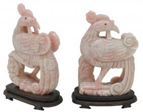 A PAIR OF LARGE ROSE QUARTZ CARVED INDONESIAN ROOS