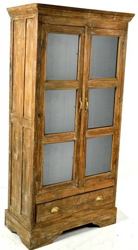A LARGE TWO DOOR PRIMITIVE CUPBOARD