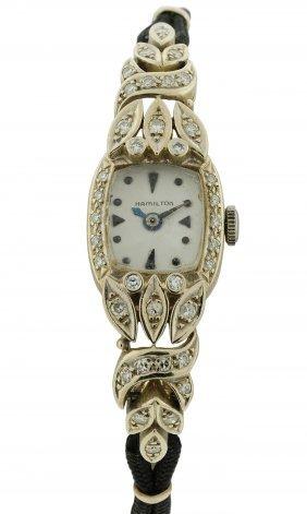 A LADY'S 14 WHITE GOLD AND DIAMOND ART DECO HAMILTON WA