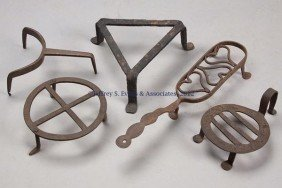 FIVE WROUGHT-IRON SMALL TRIVETS