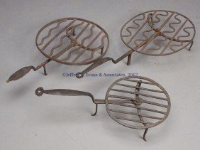 THREE WROUGHT-IRON HEARTH BROILERS