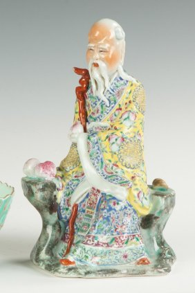 Chinese Porcelain Seated Figure With Peach