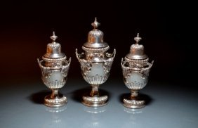 THREE GRADUATED COVERED SILVER CADDIES