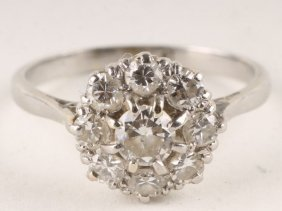 A Nine Stone Diamond Cluster Ring, Stamped 'Plat'