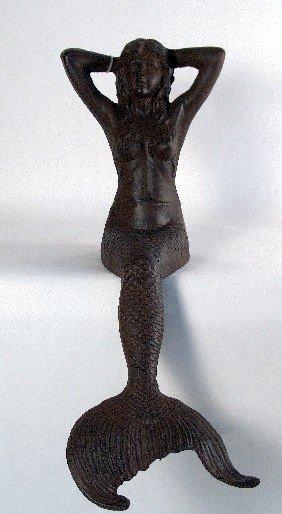 Cast Iron Seated Mermaid.