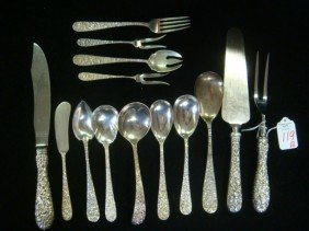 Fourteen Floral Repousse Sterling Serving Pieces:
