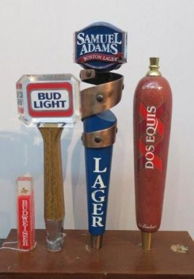 Four Beer Tap Handles On Wooden Plaque: