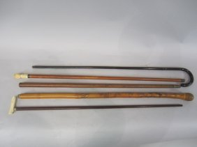 H32-4  GROUP OF 5 CANES