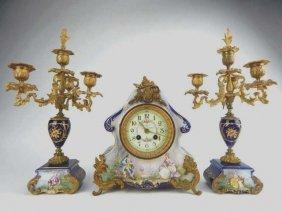 Sevres Porcelain Clock Set With Two Candelabra