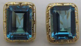 PAIR OF STAMPED 14KT GOLD EARRINGS WITH BLUE TOPA