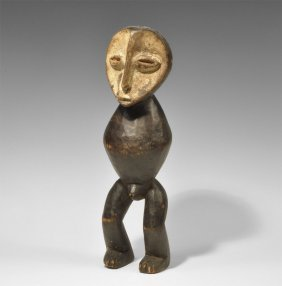 West African Wooden Armless Male Figurine