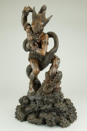 Carved Hardwood Figure Of A Deity With Snake