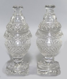 PAIR OF IRISH CUT GLASS COVERED JARS