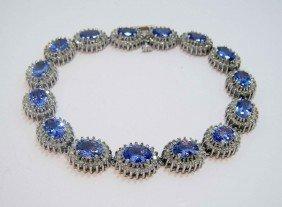 9.60ctw Tanzanite & 3.17ctw Diamond 14KT Gold Bracelet