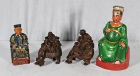 4 ORIENTAL CARVED WOOD FIGURES. 2 ARE PAINTED AND SITTI