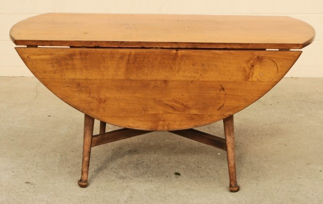 round maple drop leaf dining table resting on turned lot 62