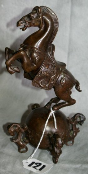 Chinese Bronze Of Rearing Horse On A Chinese Ball