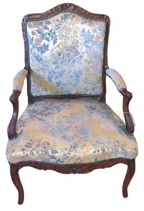 A French Regence Carved Walnut Armchair