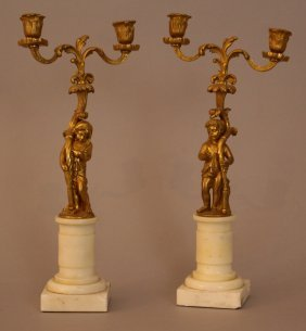 Pair Of Gilded Bronze Candelabras With Two Putti