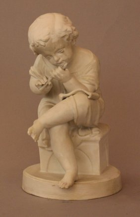 Small Biscuit Porcelain Figure Of A Sitting Young Boy