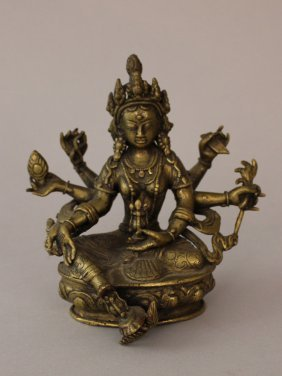 Indian Goddness In Sitting Possition With Six Hands
