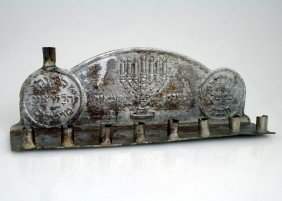 A RARE AND EARLY TIN CHANUKAH LAMP. New York, C.19
