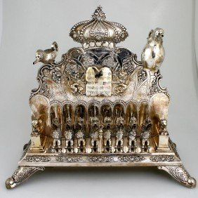 A LARGE SILVER CHANUKAH LAMP. Germany, C. 1880. On