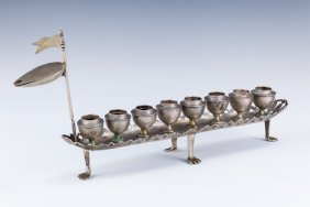 A RARE AND IMPORTANT SILVER CHANUKAH LAMP. Poland,