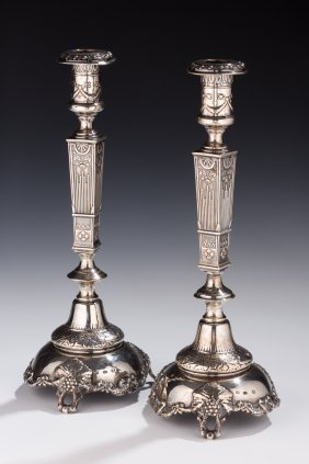 A PAIR OF SILVER CANDLESTICKS.  Warsaw, C. 1890. On Gra