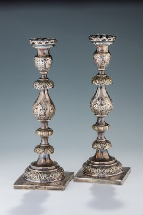 A Pair Of Silver Candlesticks By Abraham Reiner.