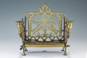 A Brass Chanukah Lamp. Poland, 19th Century. With
