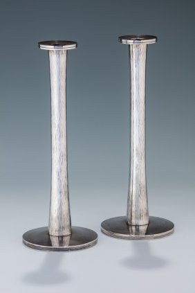 An Early Pair Of Sterling Silver Candlesticks By David