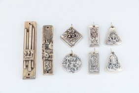 Two Sterling Mezuzot And Six Pendants By Henryk