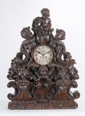 Black Forest Carved Walnut Figural Mantel Clock