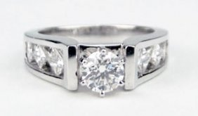 14KT WHITE GOLD DIAMOND ENGAGEMENT RING WITH ONE R