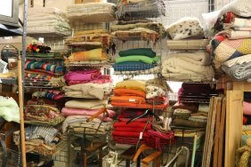 Grouping of 20 shelves of blankets incl south