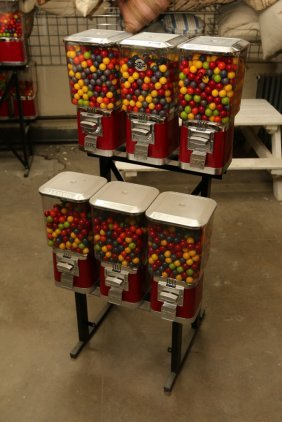 Six Gumball Machines On Stand.