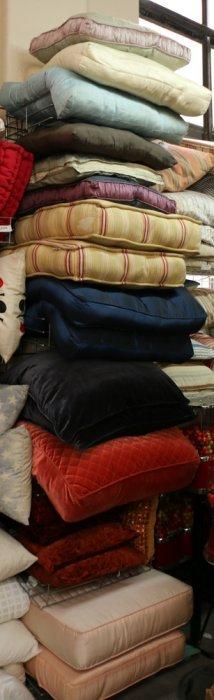 Long Vertical Shelf Unit Of Misc Pillows Colors