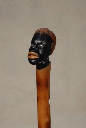 A Very Nice Wood Black Man Cane