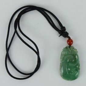 A Chinese Green Jadeite Carved Pendant With Gia