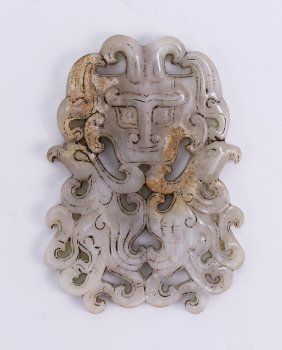 A Finely Carved White Jade Archaistic Plaque