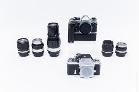 Nikon Fe And Nikon F Cameras With 5 Lenses.
