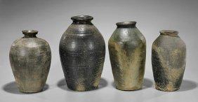 Four Chinese Black/brown Stoneware Jars