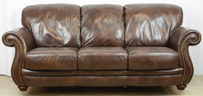 Brown leather sofa with brass studded trim lot 274 for Leather studded couch