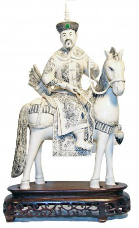 EMPEROR & EMPRESS ON HORSEBACK, PAIR OF CHINESE IVORIES