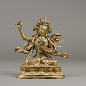 A Gilt Bronze Sculpture Of Four-armed Maitreya