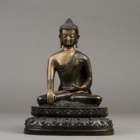 A Gilt Bronze Sculpture Of A Buddha