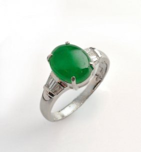 18K White Gold Ring, Set With One Oval Jade And Small D