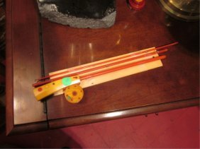 VINTAGE BAKELITE FISHING ROD, APPROX 3' LONG WHEN A